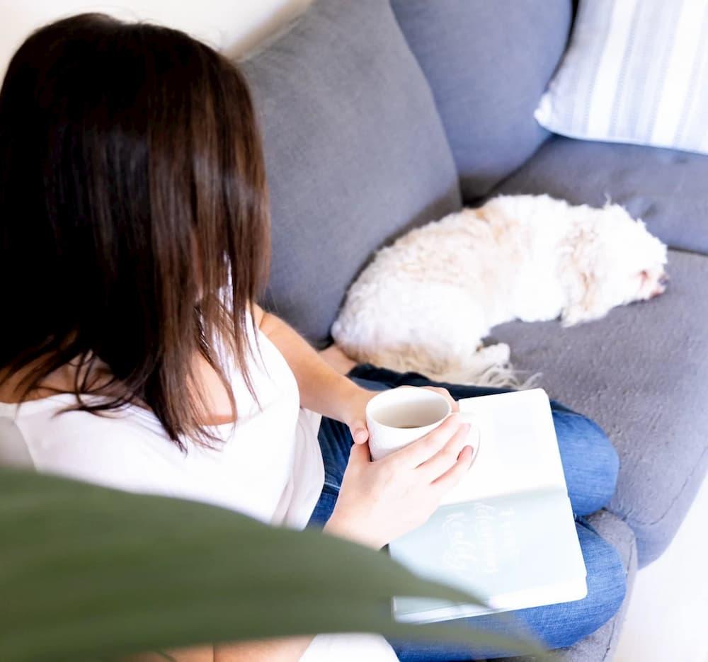Tarmala Caple on couch