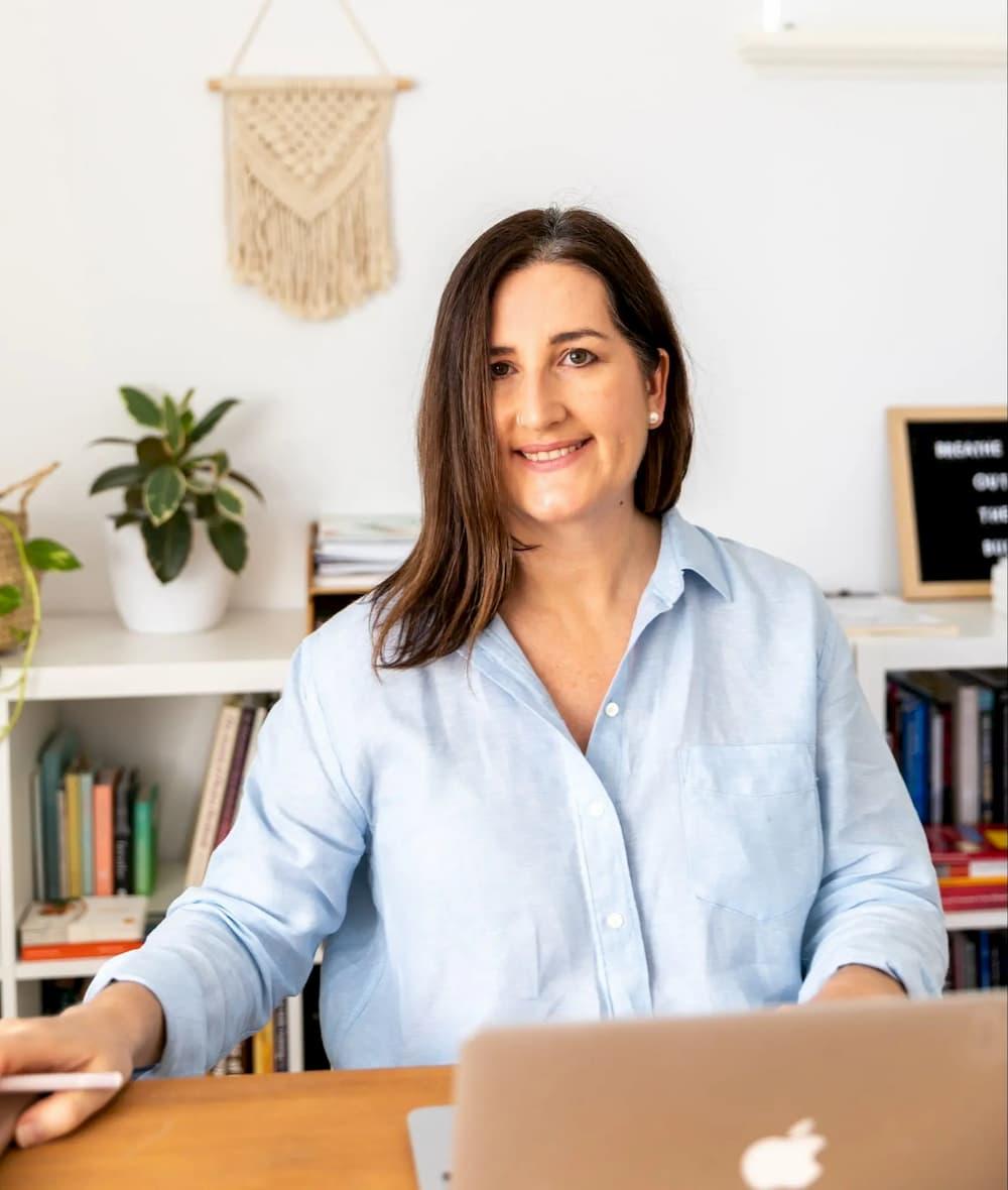 Dr Tarmala Caple working at laptop